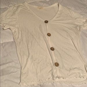 A white shortsleeved shirt with buttons